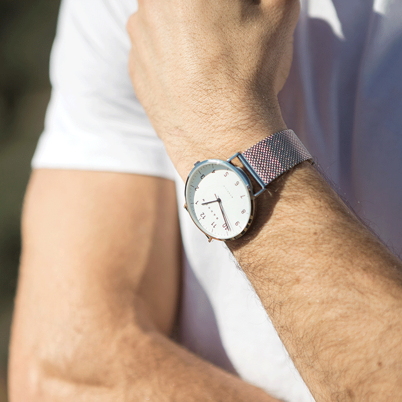 Man wearing Silver watch with silver mesh watch strap