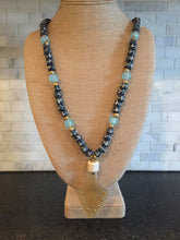 African Painted glass beads with buffalo horn pendant