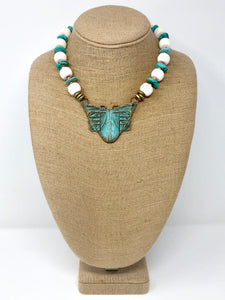 Coral necklace with moth pendant