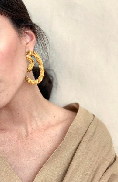 HANDMADE BEADED EARRINGS , Carolina herrera, oscar de la renta, hoops , heart earrings , maxi earrings, asymmetric earrings