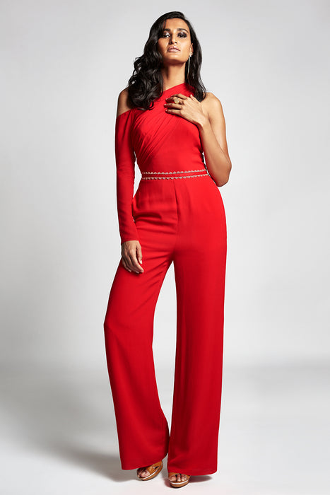 Red jumpsuit with one side drape sleeve and embellishment