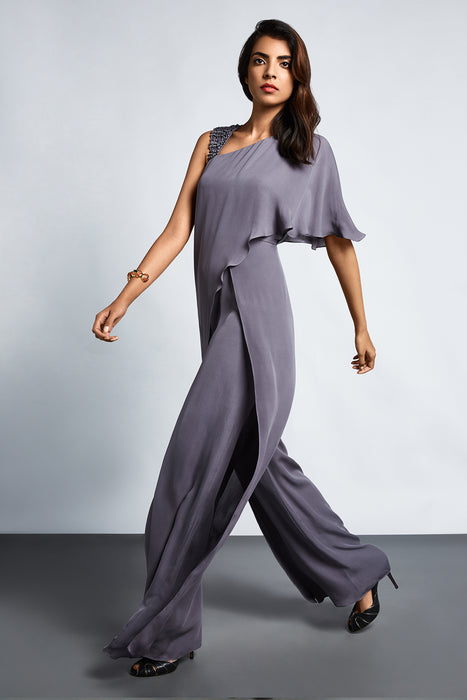 Grey jumpsuit with an overlayer drape