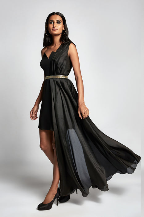 Black one shoulder gown with a silk-organza pleated overlayer