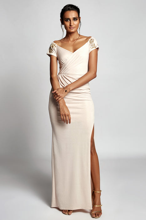 Gold shimmer off shoulder gown with embellishment detail on sleeves