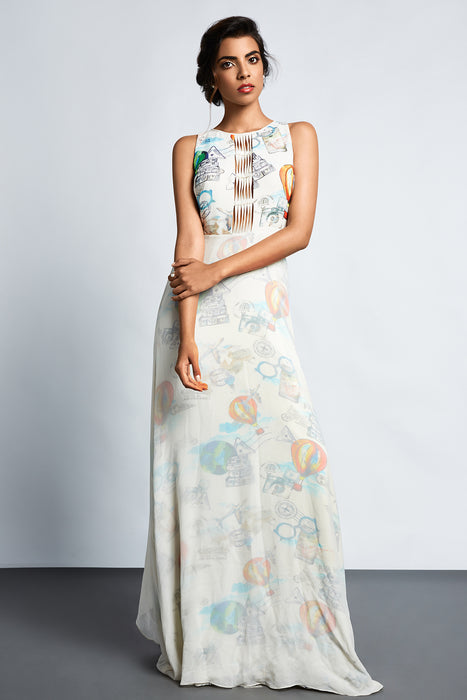 White travel print gown with a white overlay and back trail