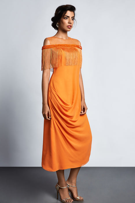 Orange dress with side cowl and fringe detail
