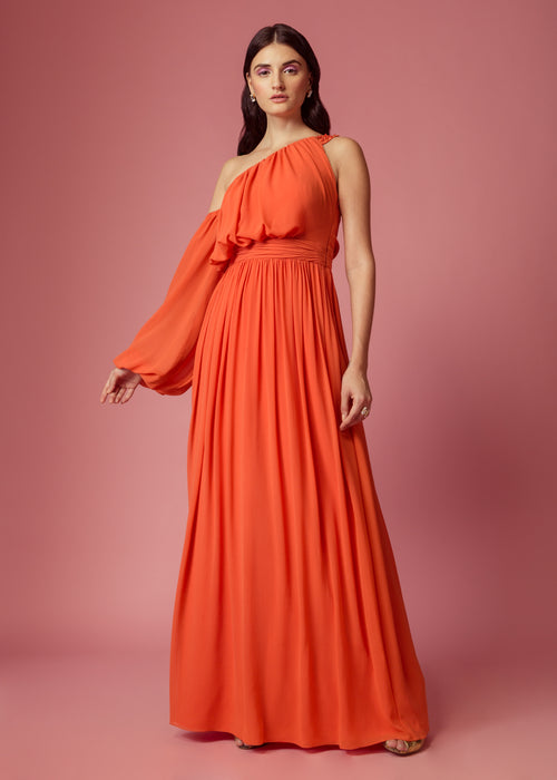 Orange drape gown with exaggerated sleeves and embellishment