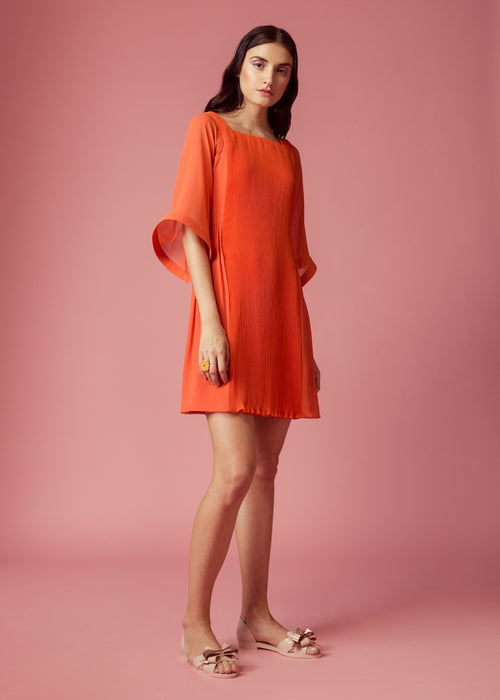 Orange pleated dress with kaftan style sleeves