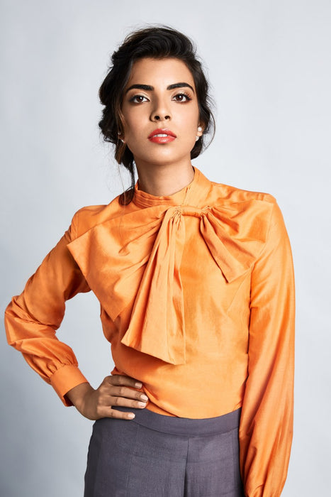 Orange shirt with tie-up bow collar