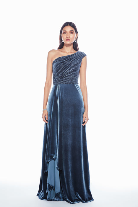 Grey pleated and plain velvet one shoulder gown with a cascade drape