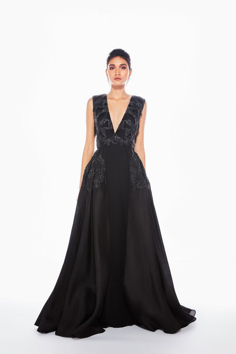Black V-neck gown with pleated drape and tube tassel embroidery