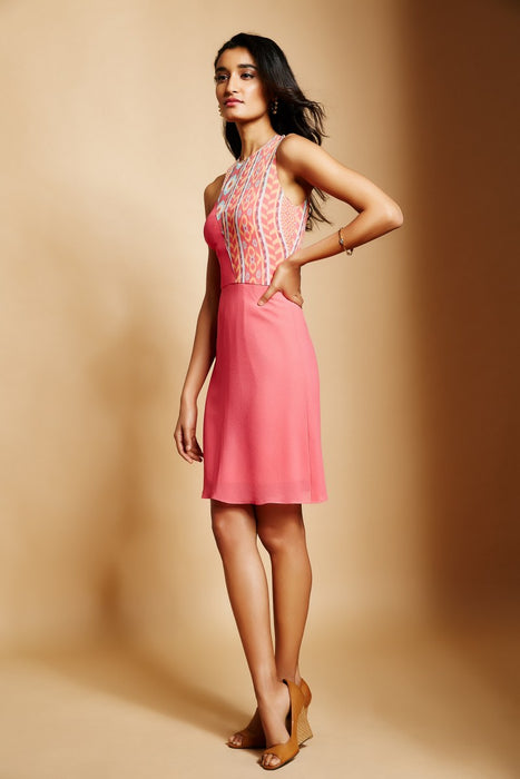 Peach one shoulder dress with peach ikat print overlayer drape