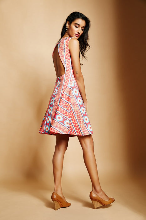 White ikat print dress with open back