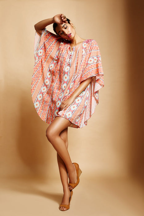 Peach Ikat stripe print dress with kaftan sleeves and cordwork detail