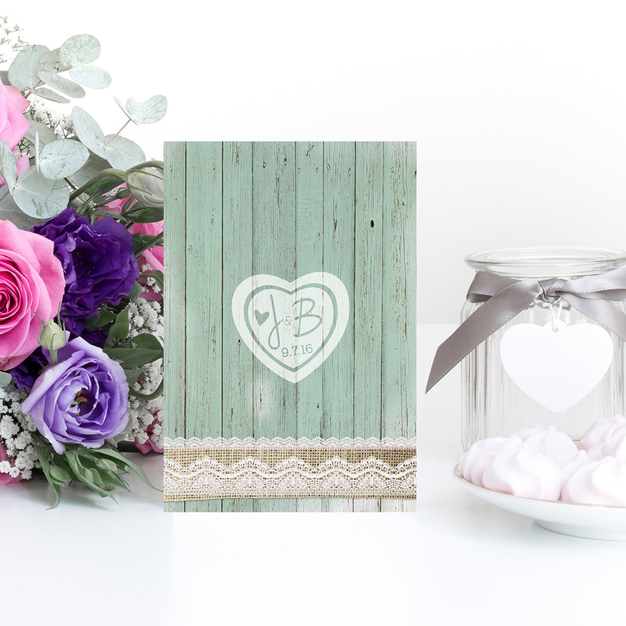 Rustic Green Wood with Festoon Lighting, Birdcages and Lace Wedding Invitations