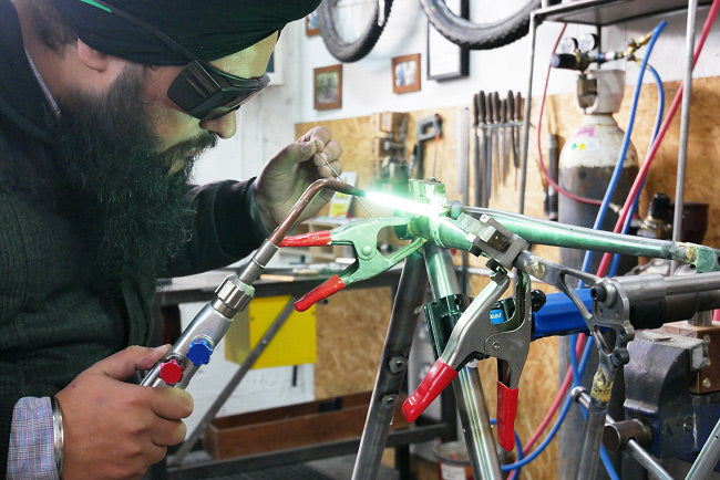 A students learns how to build steel bicycle frames, frame building jig, frame building course uk, brass fillet brazing
