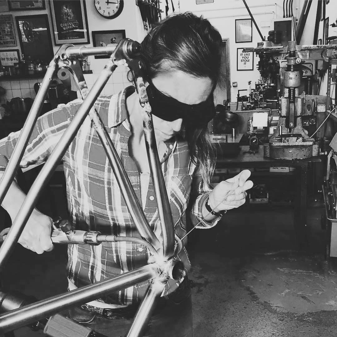 Female bicycle frame builder student, fillet brazing, bicycle frame building course, DIY cyclocross bike