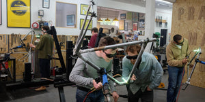 Bicycle Frame Building Course - Image of a frame building school at work - Students learn how to build a bike