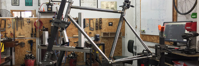 Image of a bike frame in a jig, low cost frame fixture