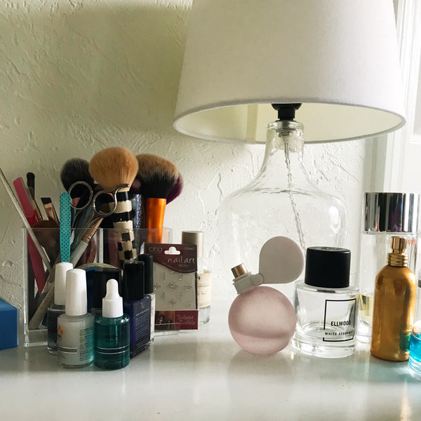 The clutter of beauty products on my vanity.