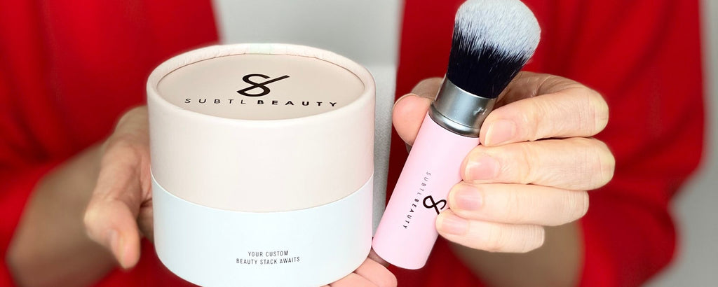 Woman holding a subtl beauty stack and a subtl beauty makeup brush
