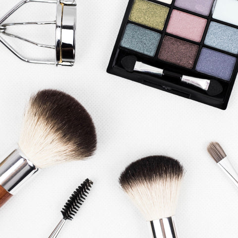 An assortment of makeup tools on a white background