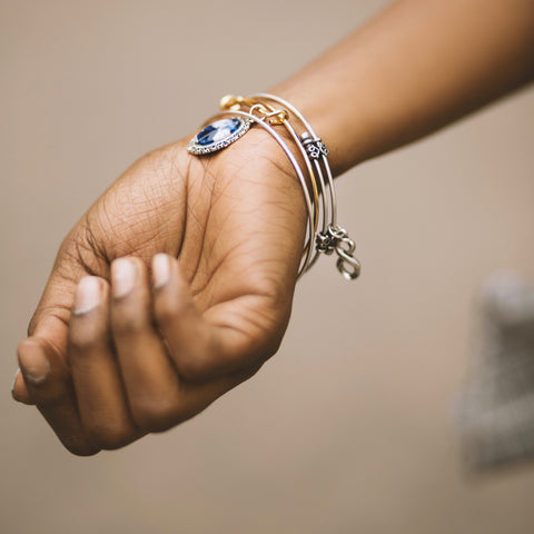 A wrist with jewelry adorning it.
