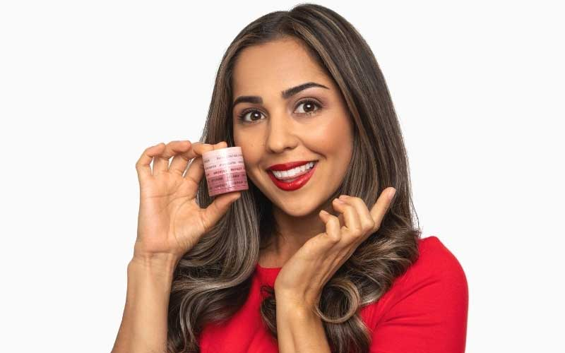 Paula holding a subtl beauty starter stack in her hand