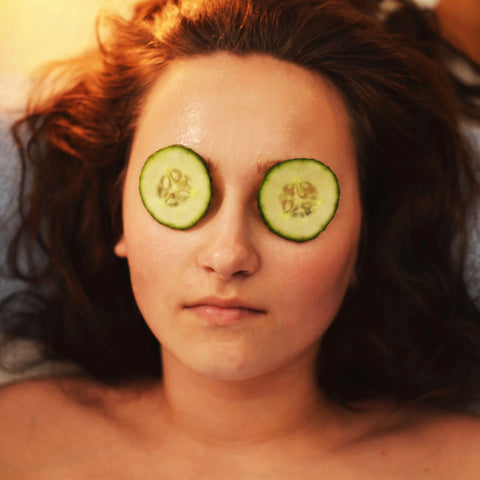 Lady with cucumbers on her eyes.