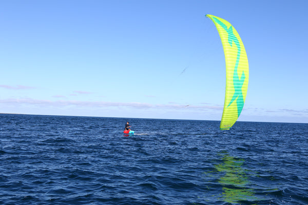 A kitesurfer using the F-One Diablo V4 kite