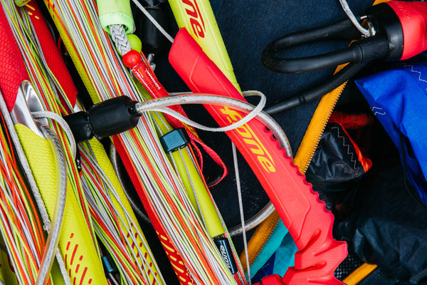 A pile of F-One kitesurfing equipment