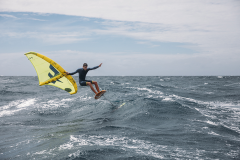 A surfer foiling with the F-One Swing