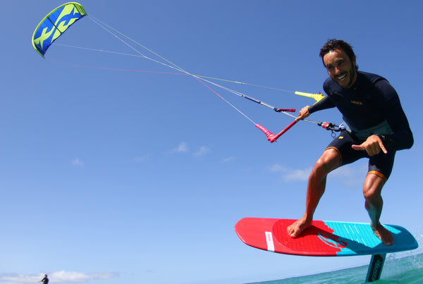 A man kitesurfing using F-One equipment