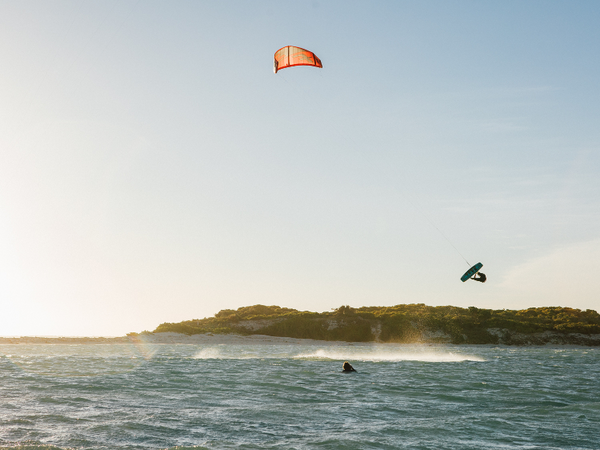 Kitesurfer in the distance in the air on a Trax HRD Lite Tech board.