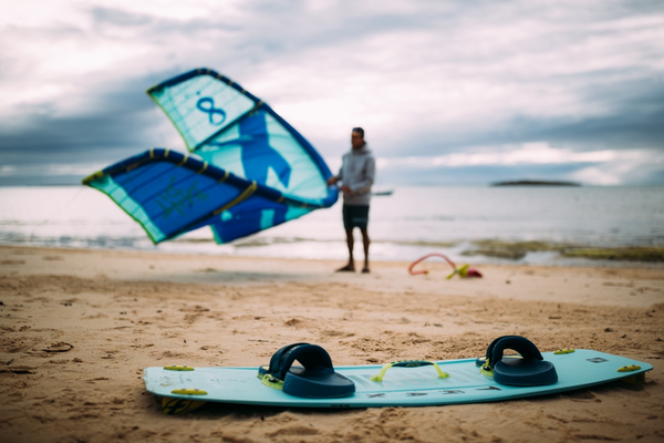 A kitesurfer preparing his F-One equipment
