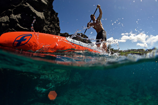 view from the sea of a paddleboarder