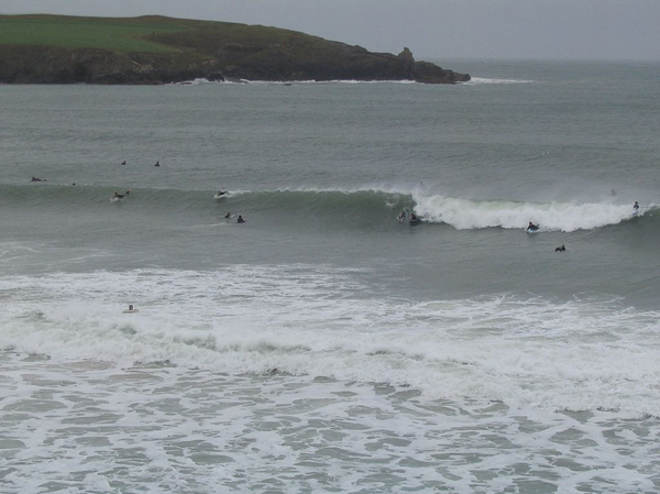 surfers and paddleboarders in the sea at Harlyn Bay