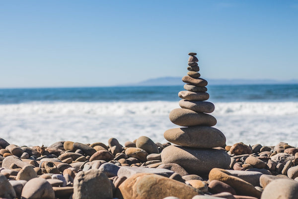 pile of stones balanced on a beach