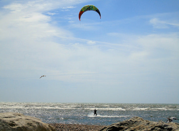 A kitesurfing riding the waves at Calshot in Hampshire