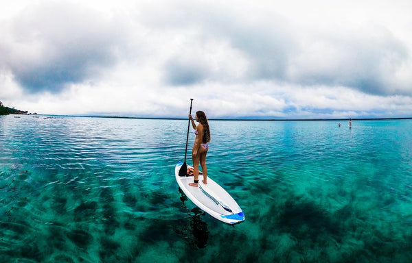 A woman on a SUP in the sea