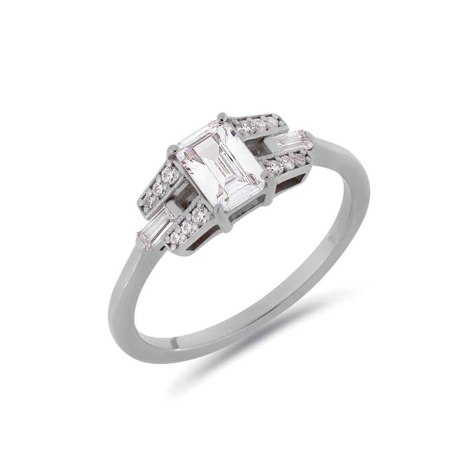 Emerald cut buckle diamond ring in white gold
