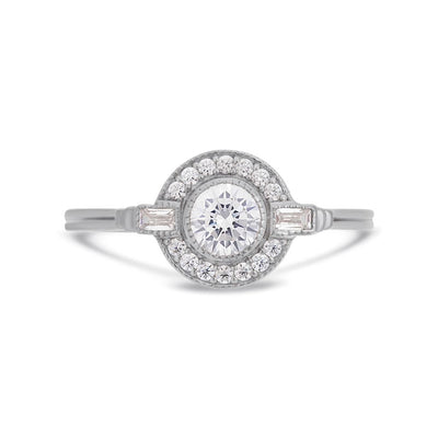 Round Art Deco diamond halo ring in platinum