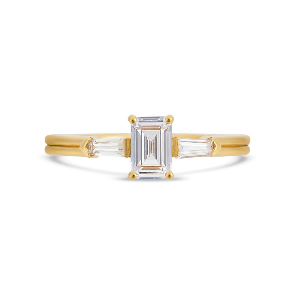 Illusion bullet & emerald cut diamond ring in yellow gold