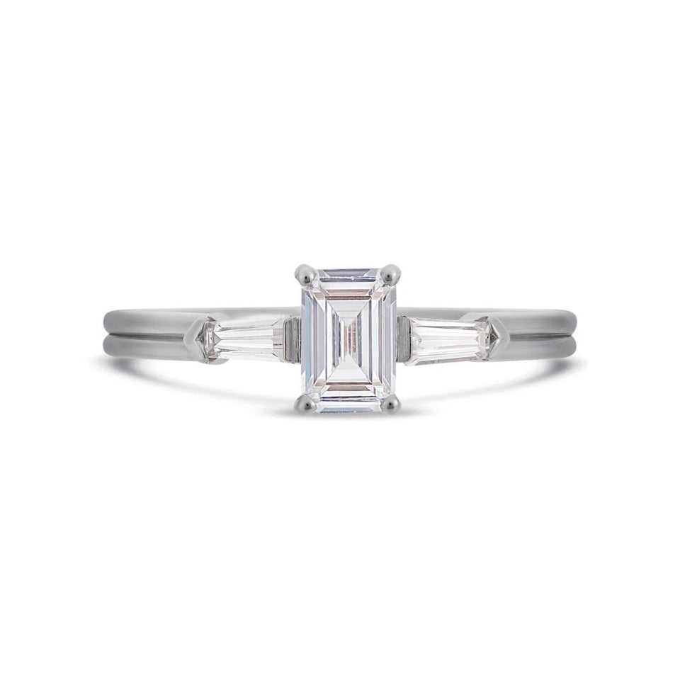 Illusion bullet & emerald cut diamond ring in platinum