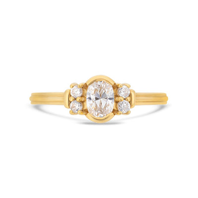 Deco oval cut solitaire diamond ring in yellow gold