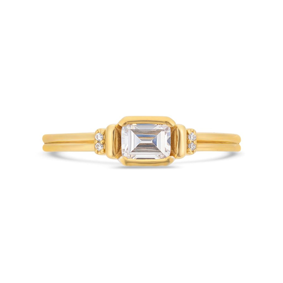 Deco emerald cut solitaire diamond ring in yellow gold
