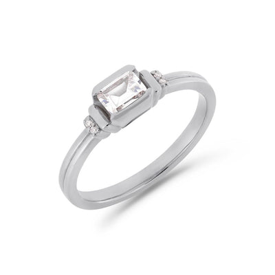 Deco emerald cut solitaire diamond ring in white gold