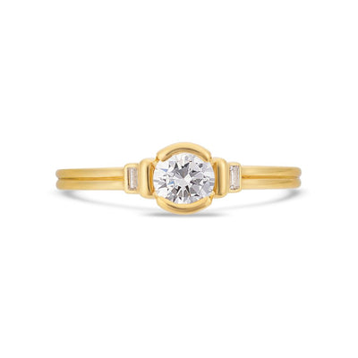 Deco brilliant cut solitaire diamond ring in yellow gold