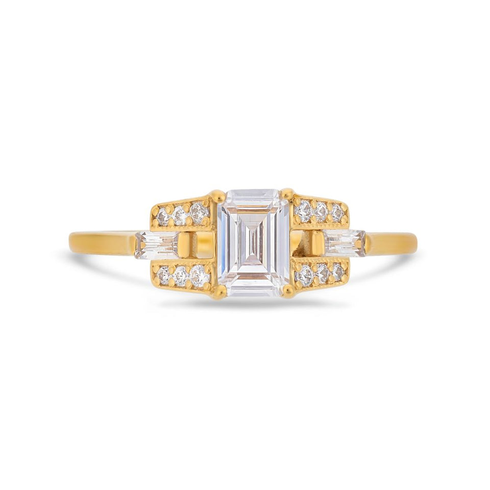 Emerald cut diamond buckle ring in yellow gold