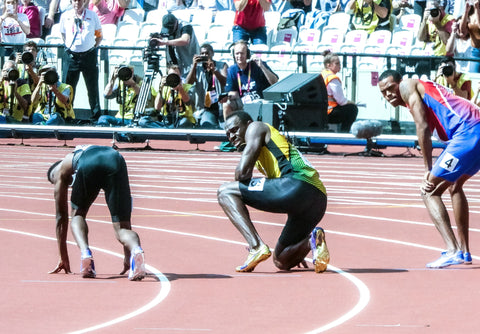 Ussain Bolt, in the middle, fastest man on earth.